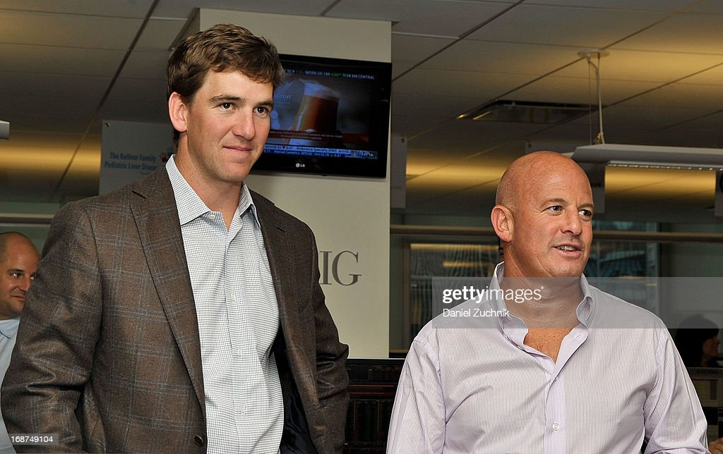 Eli Manning and Steven Starker attend the 2013 Commissions For Charity Day at BTIG on May 14, 2013 in New York City.
