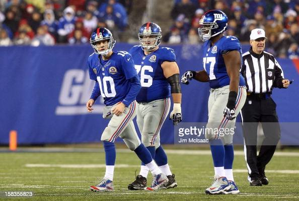 Eli Manning Chris Snee and Kevin Boothe of the New York Giants in action against the New Orleans Saints at MetLife Stadium on December 9 2012 in East...