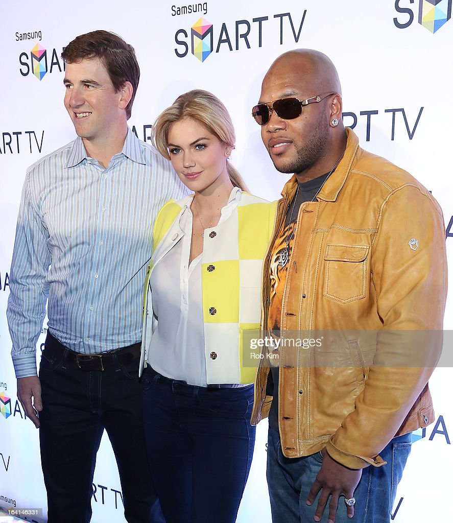 Eli Manning, Kate Upton and Flo Rida attend the launch of Samsung's 2013 Television line at Museum Of American Finance on March 20, 2013 in New York City.