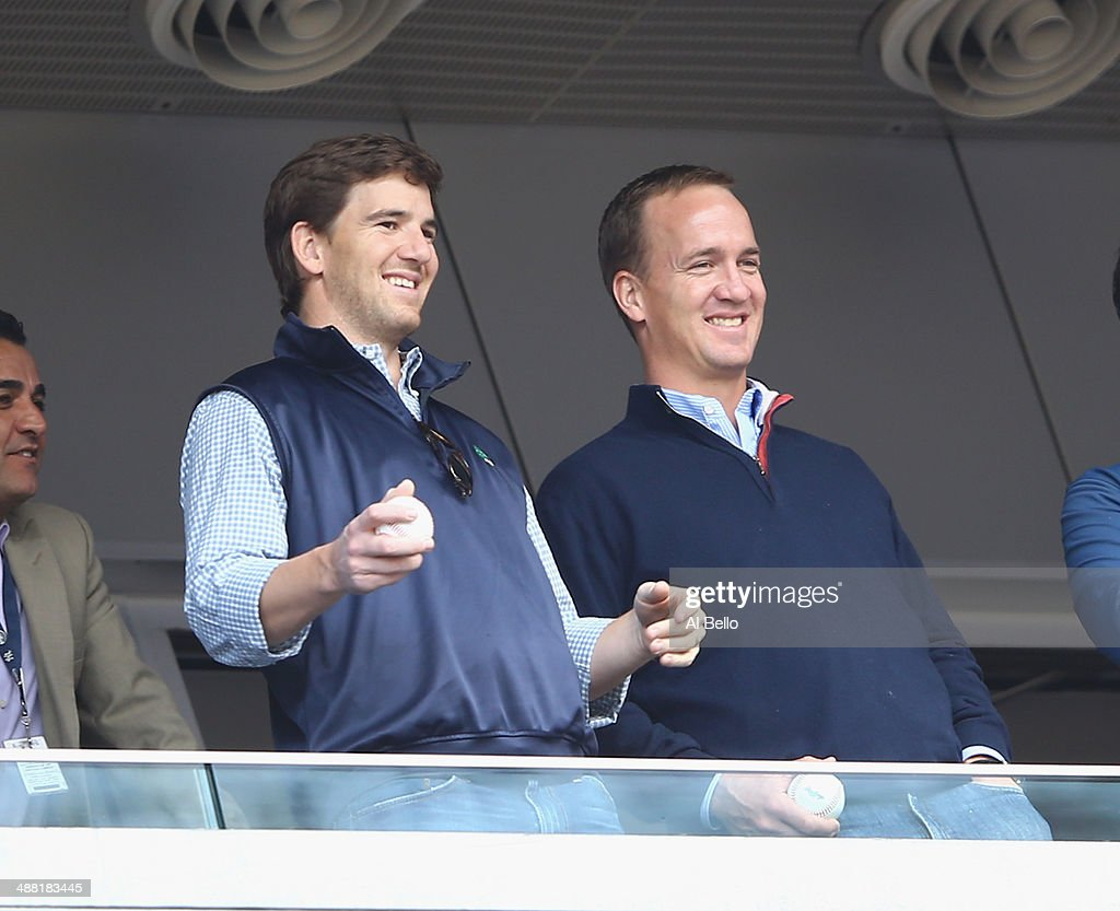 <a gi-track='captionPersonalityLinkClicked' href=/galleries/search?phrase=Eli+Manning&family=editorial&specificpeople=202013 ng-click='$event.stopPropagation()'>Eli Manning</a> of the New York Giants and <a gi-track='captionPersonalityLinkClicked' href=/galleries/search?phrase=Peyton+Manning&family=editorial&specificpeople=184524 ng-click='$event.stopPropagation()'>Peyton Manning</a> of the Denver Broncos appear at the game between the New York Yankees and the Tampa Bay Rays on May 4, 2014 in the Bronx borough of New York City.