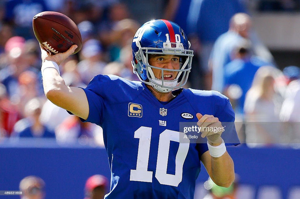 <a gi-track='captionPersonalityLinkClicked' href=/galleries/search?phrase=Eli+Manning&family=editorial&specificpeople=202013 ng-click='$event.stopPropagation()'>Eli Manning</a> #10 of the New York Giants attempts a pass in the third quarter against the Atlanta Falcons at MetLife Stadium on September 20, 2015 in East Rutherford, New Jersey.