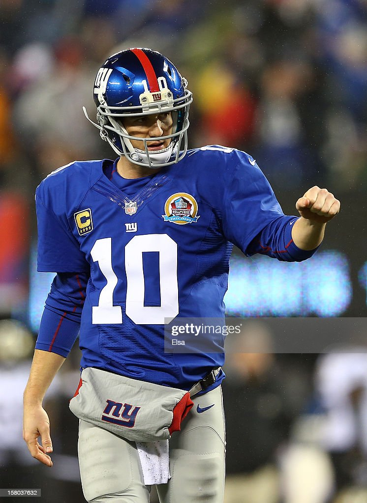 Eli Manning #10 of the New York Giants celebrates a touchdown in the third quarter against the New Orleans Saints on December 9, 2012 at MetLife Stadium in East Rutherford, New Jersey.