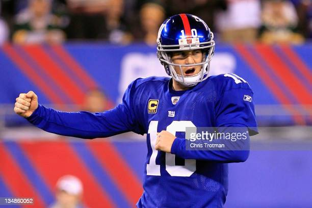 Eli Manning of the New York Giants celebrates after Brandon Jacobs scored a 1yard rushing touchdown in the second quarter against the Green Bay...