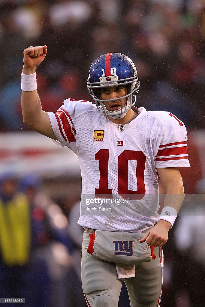 <a gi-track='captionPersonalityLinkClicked' href=/galleries/search?phrase=Eli+Manning&family=editorial&specificpeople=202013 ng-click='$event.stopPropagation()'>Eli Manning</a> #10 of the New York Giants celebrates after he threw a 6-yard touchdown pass to Bear Pascoe #86 against the San Francisco 49ers in the second quarter during the NFC Championship Game at Candlestick Park on January 22, 2012 in San Francisco, California.