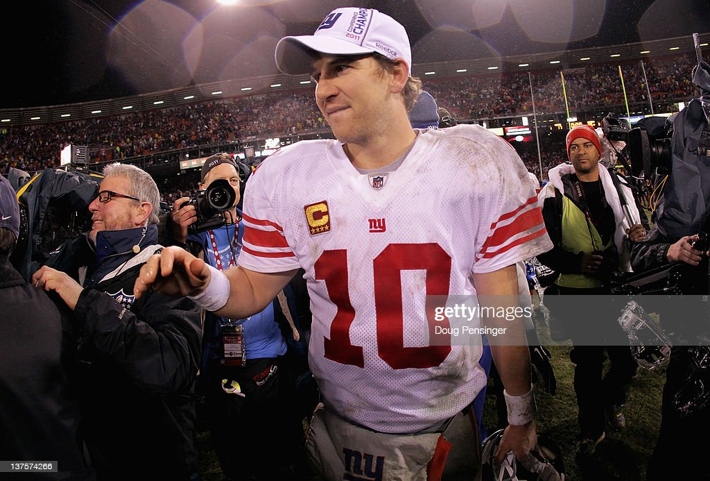 <a gi-track='captionPersonalityLinkClicked' href=/galleries/search?phrase=Eli+Manning&family=editorial&specificpeople=202013 ng-click='$event.stopPropagation()'>Eli Manning</a> #10 of the New York Giants celebrates after the GIants won 20-17 in overtime against the San Francisco 49ers during the NFC Championship Game at Candlestick Park on January 22, 2012 in San Francisco, California.