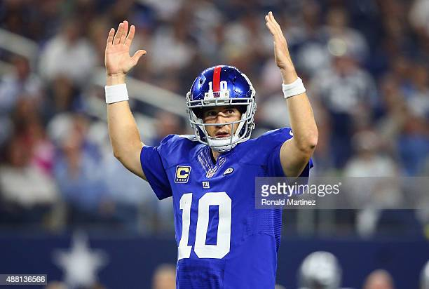 Eli Manning of the New York Giants celebrates the touchdown by Rashad Jennings in the fourth quarter against the Dallas Cowboys at ATT Stadium on...