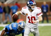 Eli Manning of the New York Giants escapes the rush of Nick Fairley of the Detroit Lions during the fourth quarter at Ford Field on December 22 2013...