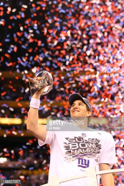 Eli Manning of the New York Giants hoist the Vince Lombardi Trophy after defeating the New England Patriots in Super Bowl XLVI at Lucas Oil Stadium...