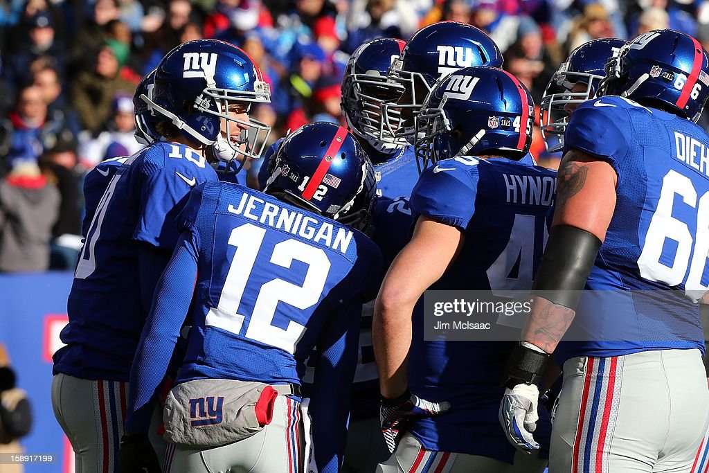 Eli Manning #10 of the New York Giants huddles with his teammates against the Philadelphia Eagles at MetLife Stadium on December 30, 2012 in East Rutherford, New Jersey. The Giants defeated the Eagles 42-7.