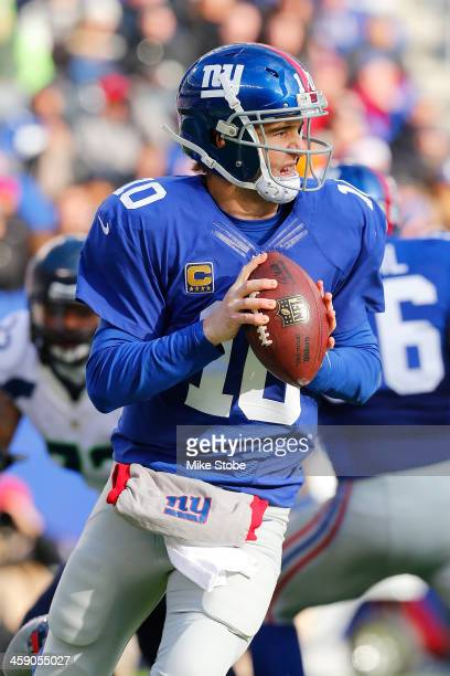 Eli Manning of the New York Giants in action against Seattle Seahawks at MetLife Stadium on December 15 2013 in East Rutherford New Jersey The...