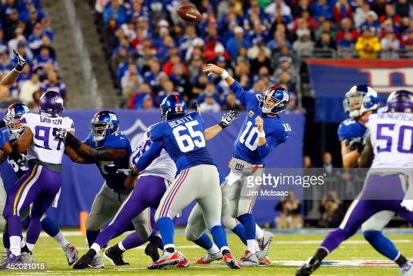 Eli Manning of the New York Giants in action against the Minnesota Vikings on October 21 2013 at MetLife Stadium in East Rutherford New Jersey The...