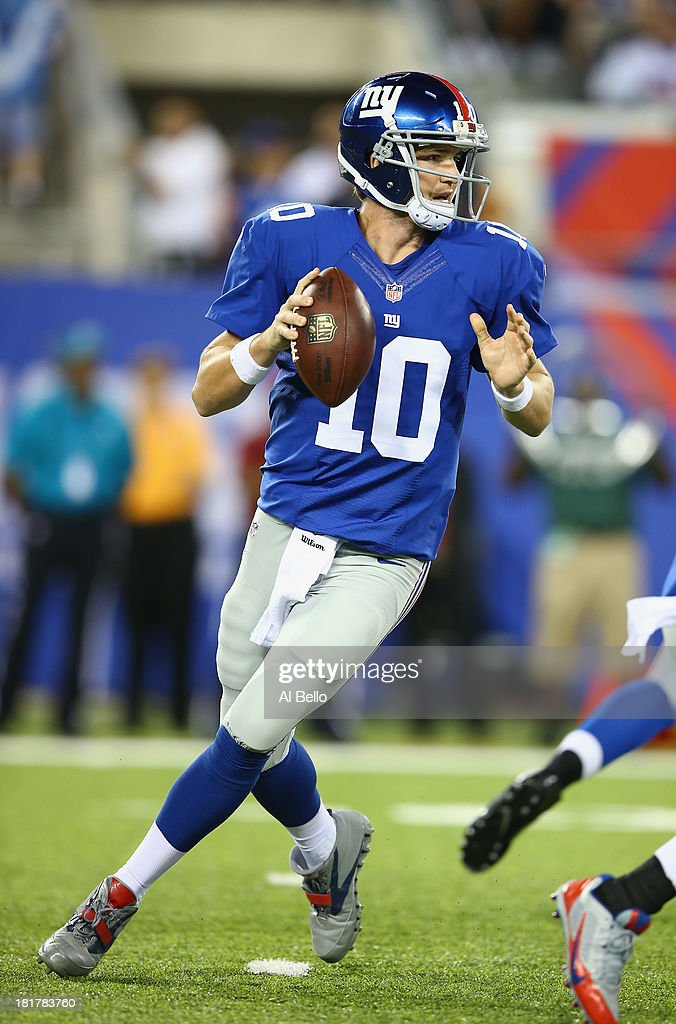 <a gi-track='captionPersonalityLinkClicked' href=/galleries/search?phrase=Eli+Manning&family=editorial&specificpeople=202013 ng-click='$event.stopPropagation()'>Eli Manning</a> #10 of the New York Giants in action against the New York Jets during their pre season game at MetLife Stadium on August 24, 2013 in East Rutherford, New Jersey.