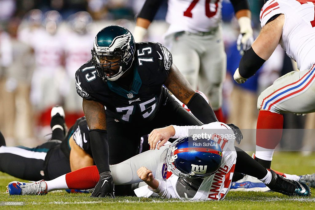 Eli Manning of the New York Giants is taken down by Vinny Curry of the Philadelphia Eagles during the third quarter at Lincoln Financial Field on...