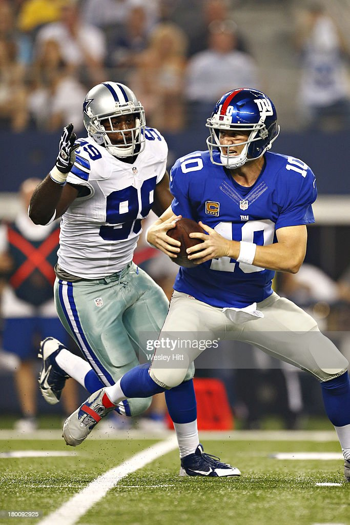 <a gi-track='captionPersonalityLinkClicked' href=/galleries/search?phrase=Eli+Manning&family=editorial&specificpeople=202013 ng-click='$event.stopPropagation()'>Eli Manning</a> #10 of the New York Giants is under pressure from the pass rush of <a gi-track='captionPersonalityLinkClicked' href=/galleries/search?phrase=George+Selvie&family=editorial&specificpeople=4483733 ng-click='$event.stopPropagation()'>George Selvie</a> #99 of the Dallas Cowboys at AT&T Stadium on September 8, 2013 in Arlington, Texas.