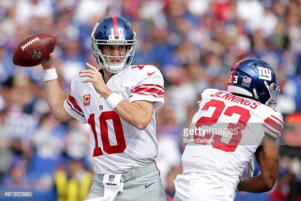 Eli Manning of the New York Giants looks to throw against the Buffalo Bills during the first half at Ralph Wilson Stadium on October 4 2015 in...