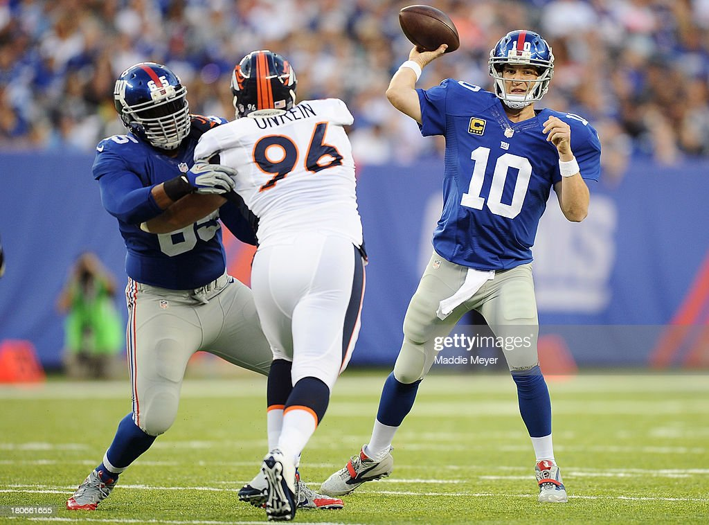 <a gi-track='captionPersonalityLinkClicked' href=/galleries/search?phrase=Eli+Manning&family=editorial&specificpeople=202013 ng-click='$event.stopPropagation()'>Eli Manning</a> #10 of the New York Giants makes a pass during the first half against the Denver Broncos at MetLife Stadium on September 15, 2013 in East Rutherford, New Jersey.