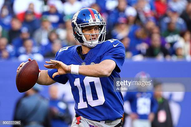 Eli Manning of the New York Giants passes against the New York Jets in the fourth quarter at MetLife Stadium on December 6 2015 in East Rutherford...