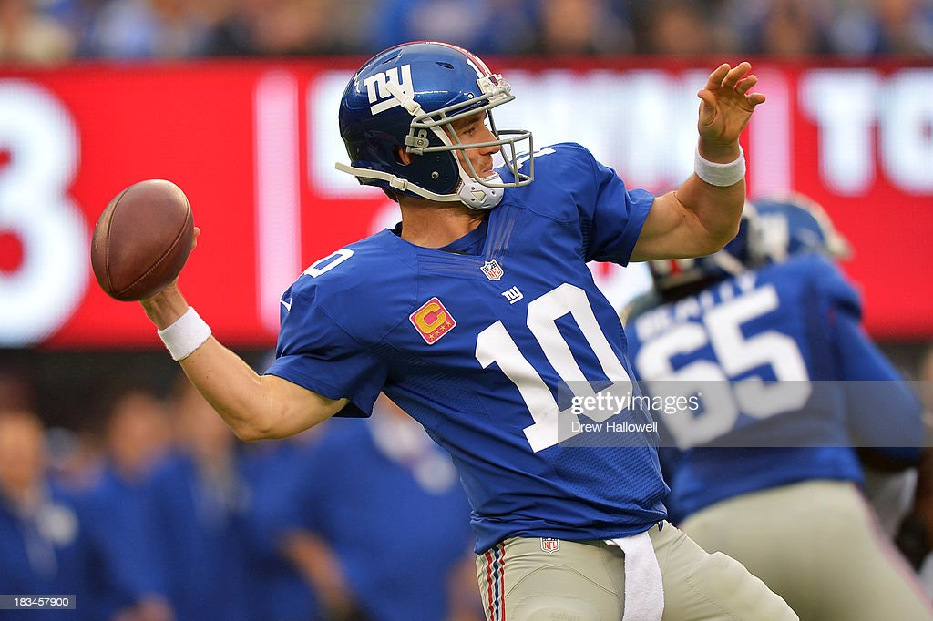 <a gi-track='captionPersonalityLinkClicked' href=/galleries/search?phrase=Eli+Manning&family=editorial&specificpeople=202013 ng-click='$event.stopPropagation()'>Eli Manning</a> #10 of the New York Giants passes against the Philadelphia Eagles at MetLife Stadium on October 6, 2013 in East Rutherford, New Jersey. The Eagles won 36-21.