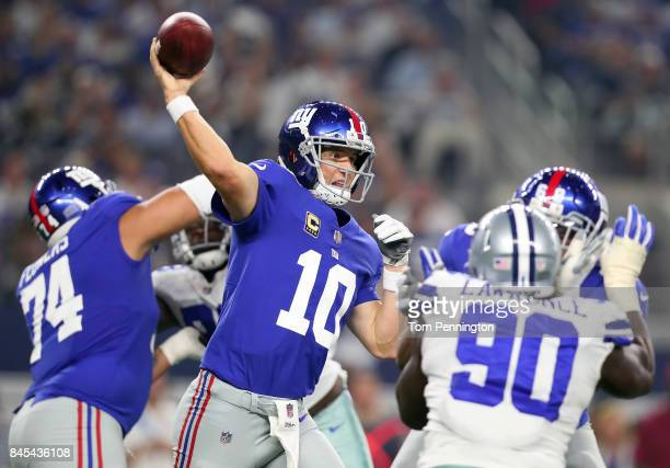 Eli Manning of the New York Giants passes the ball against the Dallas Cowboys in the second quarter at ATT Stadium on September 10 2017 in Arlington...