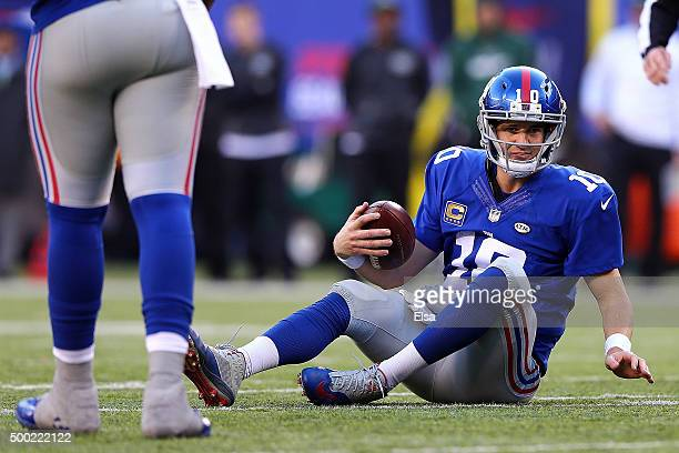 Eli Manning of the New York Giants reacts after getting sacked in the fourth quarter against the New York Jets at MetLife Stadium on December 6 2015...