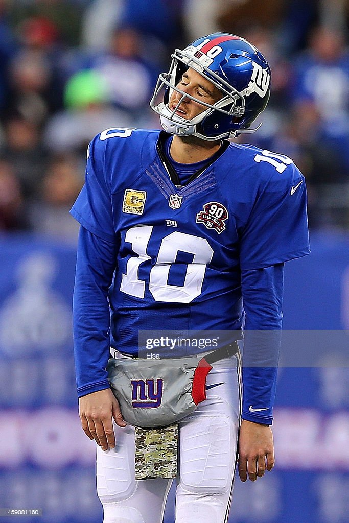 Eli Manning of the New York Giants reacts after throwing an interception in the fourth quarter against the San Francisco 49ers at MetLife Stadium on...