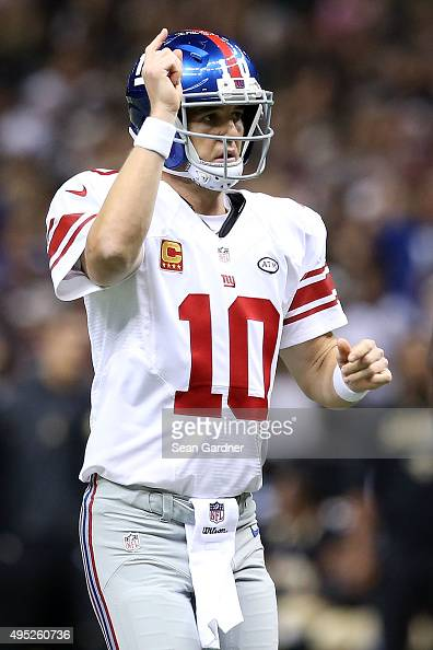 Eli Manning of the New York Giants reacts to a touchdown during the second quarter of a game against the New Orleans Saints at the MercedesBenz...