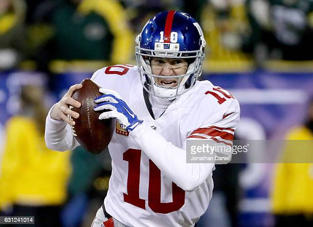 Eli Manning of the New York Giants scrambles in the second quarter during the NFC Wild Card game against the Green Bay Packers at Lambeau Field on...