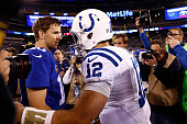 Eli Manning of the New York Giants shakes hands with Andrew Luck of the Indianapolis Colts after their game at MetLife Stadium on November 3 2014 in...