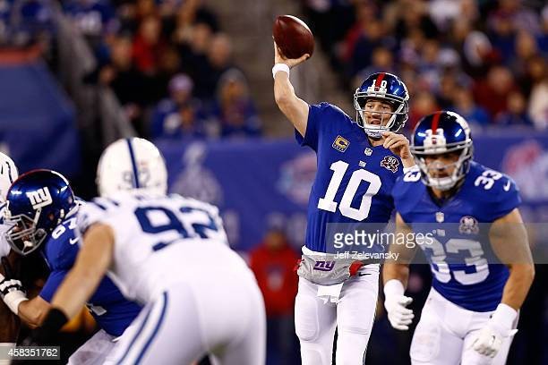 Eli Manning of the New York Giants throws a pass against the Indianapolis Colts in the first quarter during their game at MetLife Stadium on November...
