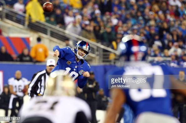 Eli Manning of the New York Giants throws a pass against the New Orleans Saints to teammate Domenik Hixon at MetLife Stadium on December 9 2012 in...