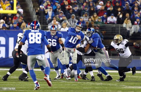 Eli Manning of the New York Giants throws a pass against the New Orleans Saints to teammate Hakeem Nicks at MetLife Stadium on December 9 2012 in...