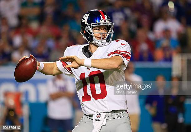 Eli Manning of the New York Giants throws during the second half of the game against the Miami Dolphins at Sun Life Stadium on December 14 2015 in...