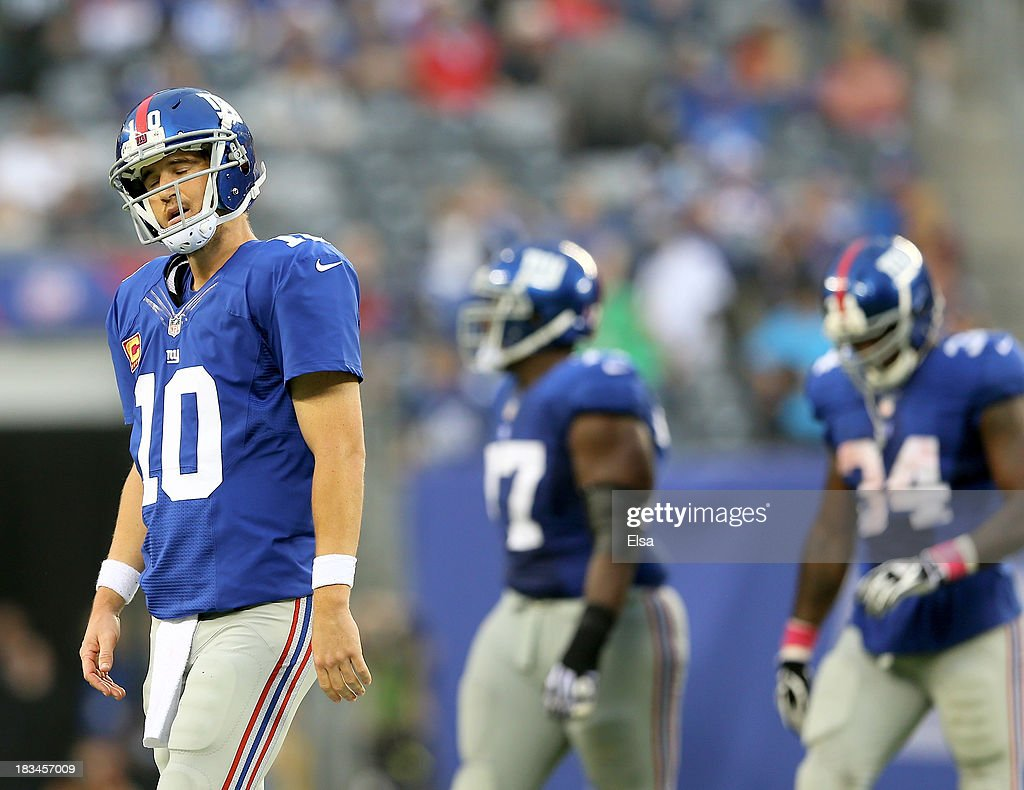 Eli Manning #10 of the New York Giants walks off the field after throwing an interception in the fourth quarter against the Philadelphia Eagles at MetLife Stadium on October 6, 2013 in East Rutherford, New Jersey.The Philadelphia Eagles defeated the New York Giants 36-21.