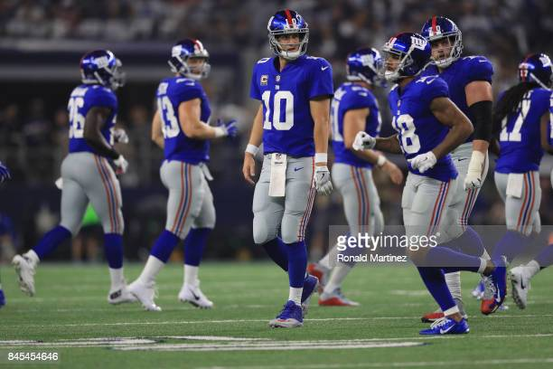 Eli Manning of the New York Giants walks off the field during play against the Dallas Cowboys at ATT Stadium on September 10 2017 in Arlington Texas