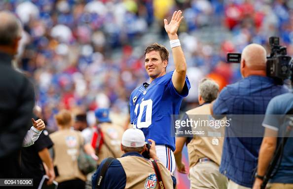 Eli Manning of the New York Giants waves to the crowd after defeating the New Orleans Saints on September 18 2016 at MetLife Stadium in East...