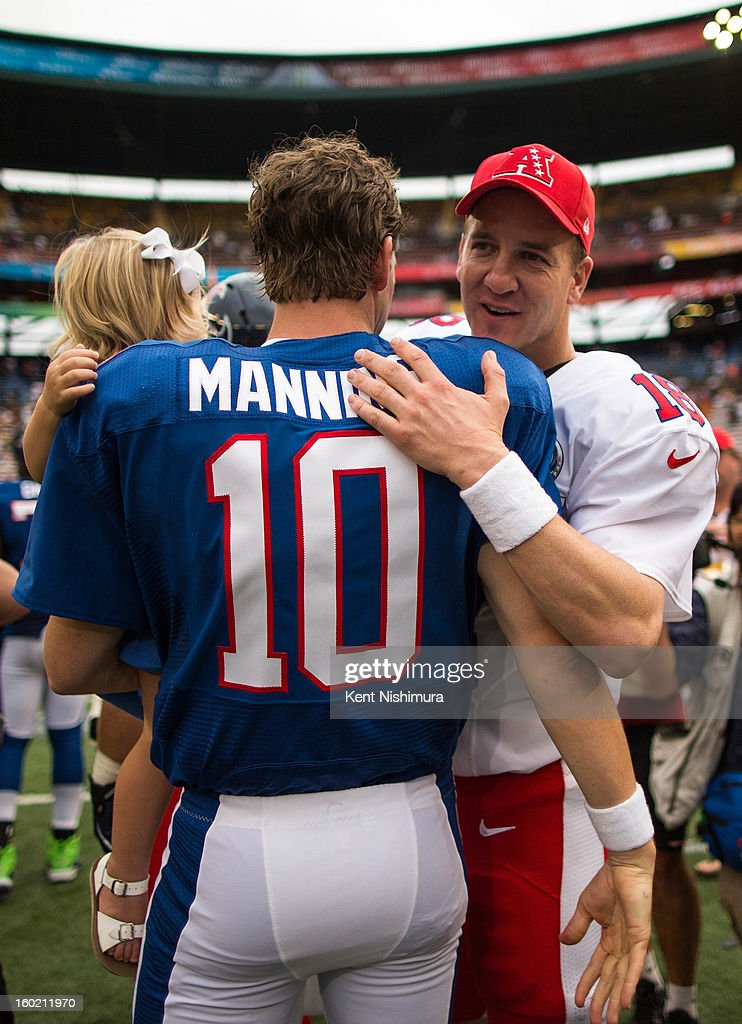 Eli Manning #10 of the NFC's New York Giants greets his brother Peyton Manning #18 of the AFC's Denver Broncos after the conclusion of the 2013 AFC-NFC Pro Bowl on January 27 , 2013 at Aloha Stadium in Honolulu, Hawaii.