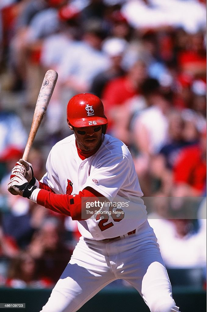 Eli Marrero of the St Louis Cardinals bats against the Cincinnati Reds at Busch Stadium on May 19 2002 in St Louis Missouri The Cardinals defeated...