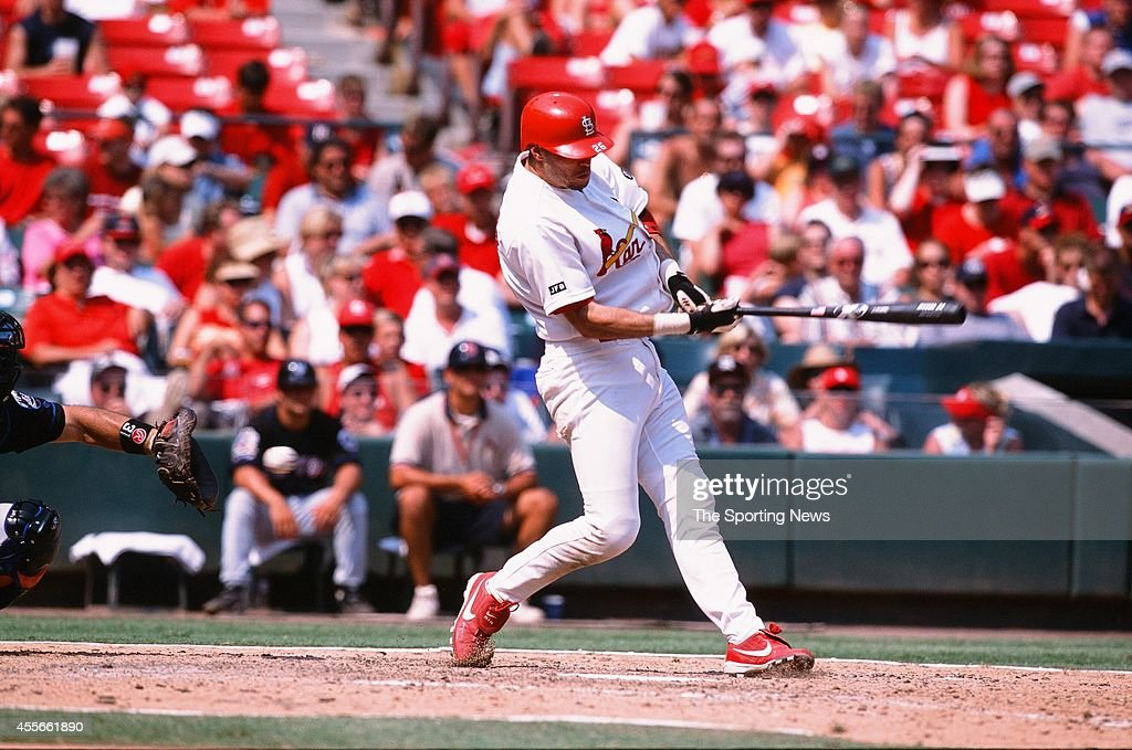 Eli Marrero of the St Louis Cardinals bats against the New York Mets at Busch Stadium on August 10 2002 in St Louis Missouri The Cardinals defeated...