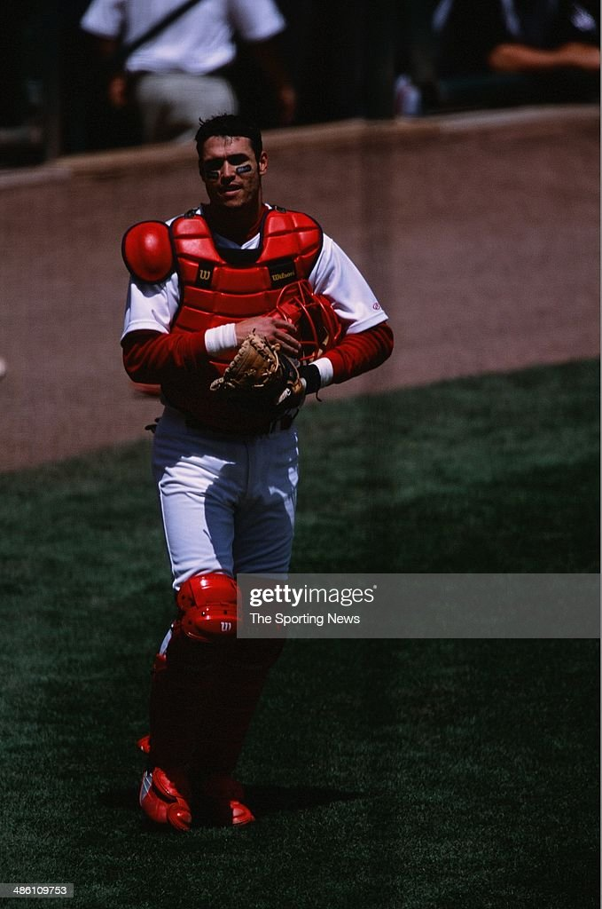Eli Marrero of the St Louis Cardinals catches against the Cincinnati Reds at Busch Stadium on May 19 2002 in St Louis Missouri The Cardinals defeated...