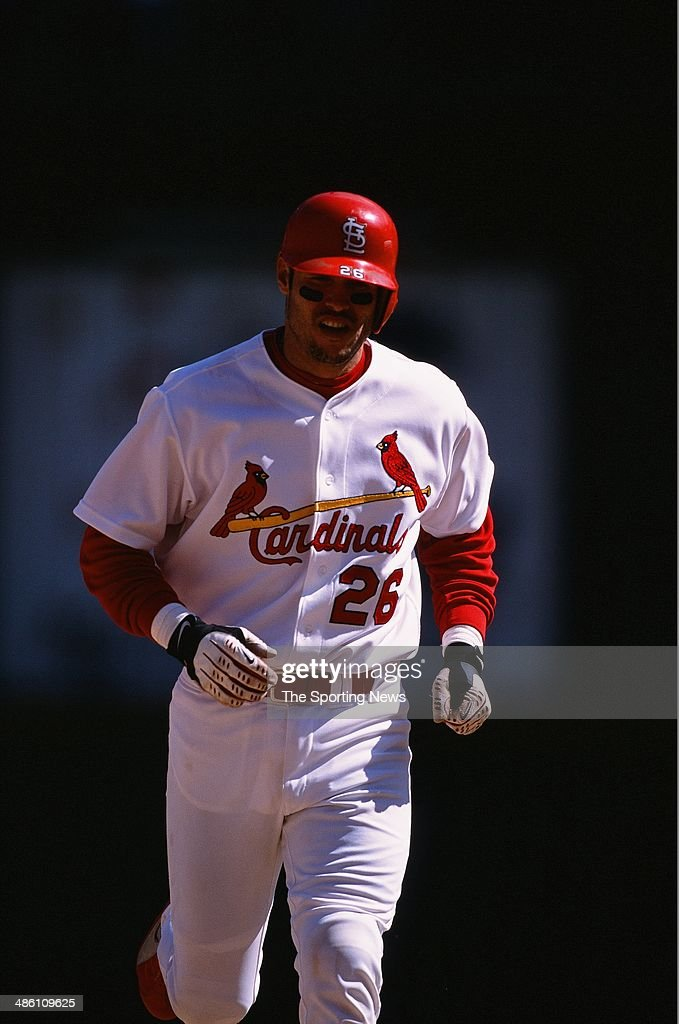 Eli Marrero of the St Louis Cardinals runs against the Cincinnati Reds at Busch Stadium on May 19 2002 in St Louis Missouri The Cardinals defeated...