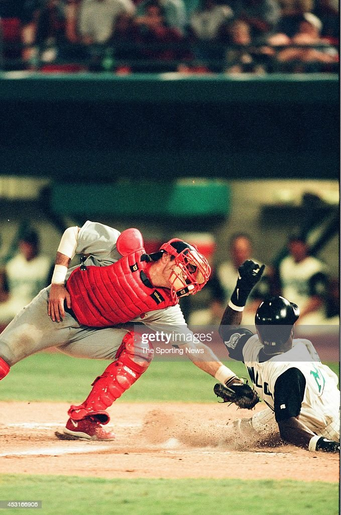 Eli Marrero of the St Louis Cardinals tags the runner against the Florida Marlins at Pro Player Stadium on September 2 1998 in Miami Gardens Florida