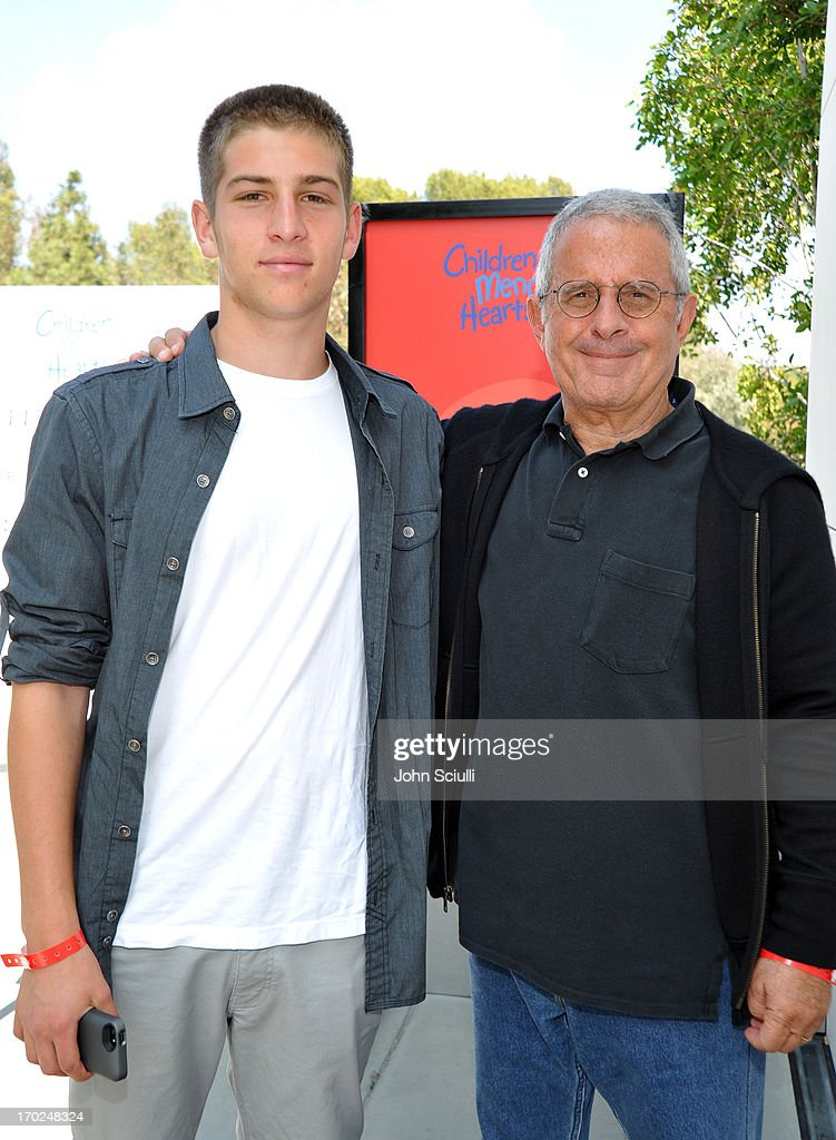Eli Meyer (L) and President & COO of Universal Studios Ron Meyer arrive at the 1st Annual Children Mending Hearts Style Sunday on June 9, 2013 in Beverly Hills, California.