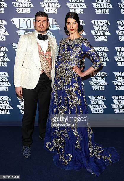 Eli Mizrahi and Crystal Renn attends the L'Oreal Paris Blue Obsession Party at the annual 69th Cannes Film Festival at Hotel Martinez on May 18 2016...