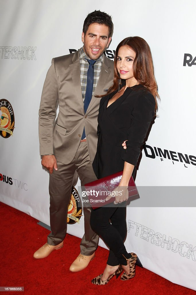 <a gi-track='captionPersonalityLinkClicked' href=/galleries/search?phrase=Eli+Roth&family=editorial&specificpeople=543948 ng-click='$event.stopPropagation()'>Eli Roth</a> and <a gi-track='captionPersonalityLinkClicked' href=/galleries/search?phrase=Azita+Ghanizada&family=editorial&specificpeople=4647934 ng-click='$event.stopPropagation()'>Azita Ghanizada</a> arrive at the 'AFTERSHOCK' premiere presented by Dimension Films and RADiUS-TWC in partnership with Shock Top - Red Carpet on May 1, 2013 in Los Angeles, California.