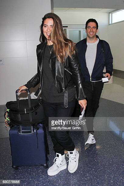 Eli Roth and Lorenza Izzo are seen at LAX on December 19 2016 in Los Angeles California