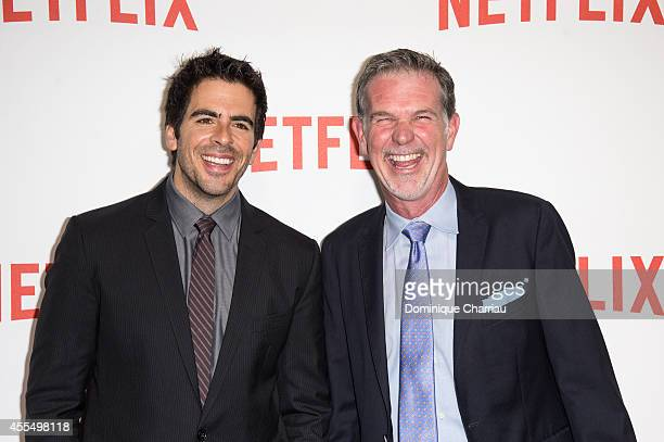 Eli Roth and Reed Hasting attend the 'Netflix' Launch Party At Le Faust In Paris on September 15 2014 in Paris France