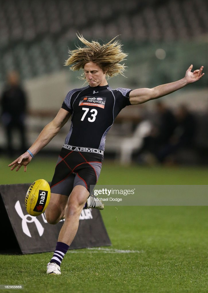 Eli Templeton of the Burnie Dockers, who looks like Dyson Heppell of the Bombers, kicks the ball during the 2013 AFL Draft Combine at Etihad Stadium on October 3, 2013 in Melbourne, Australia.