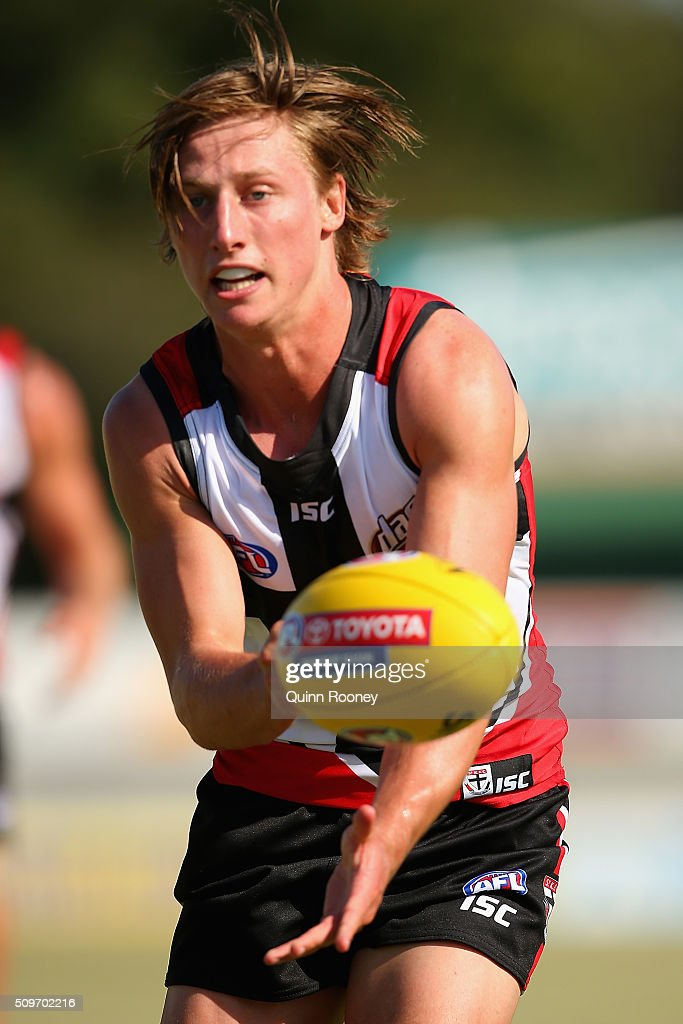 <a gi-track='captionPersonalityLinkClicked' href=/galleries/search?phrase=Eli+Templeton&family=editorial&specificpeople=11097489 ng-click='$event.stopPropagation()'>Eli Templeton</a> of the Saints handballs during the St Kilda Saints AFL Intra-Club Match at Trevor Barker Beach Oval on February 12, 2016 in Melbourne, Australia.