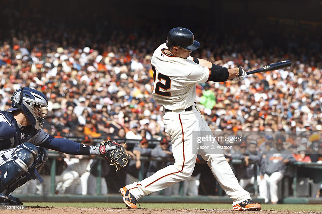 <a gi-track='captionPersonalityLinkClicked' href=/galleries/search?phrase=Eli+Whiteside&family=editorial&specificpeople=836374 ng-click='$event.stopPropagation()'>Eli Whiteside</a> #22 of the San Francisco Giants at bat against the San Diego Padres during the fourth inning at AT&T Park on September 23, 2012 in San Francisco, California. The Padres defeated the Giants 6-4.