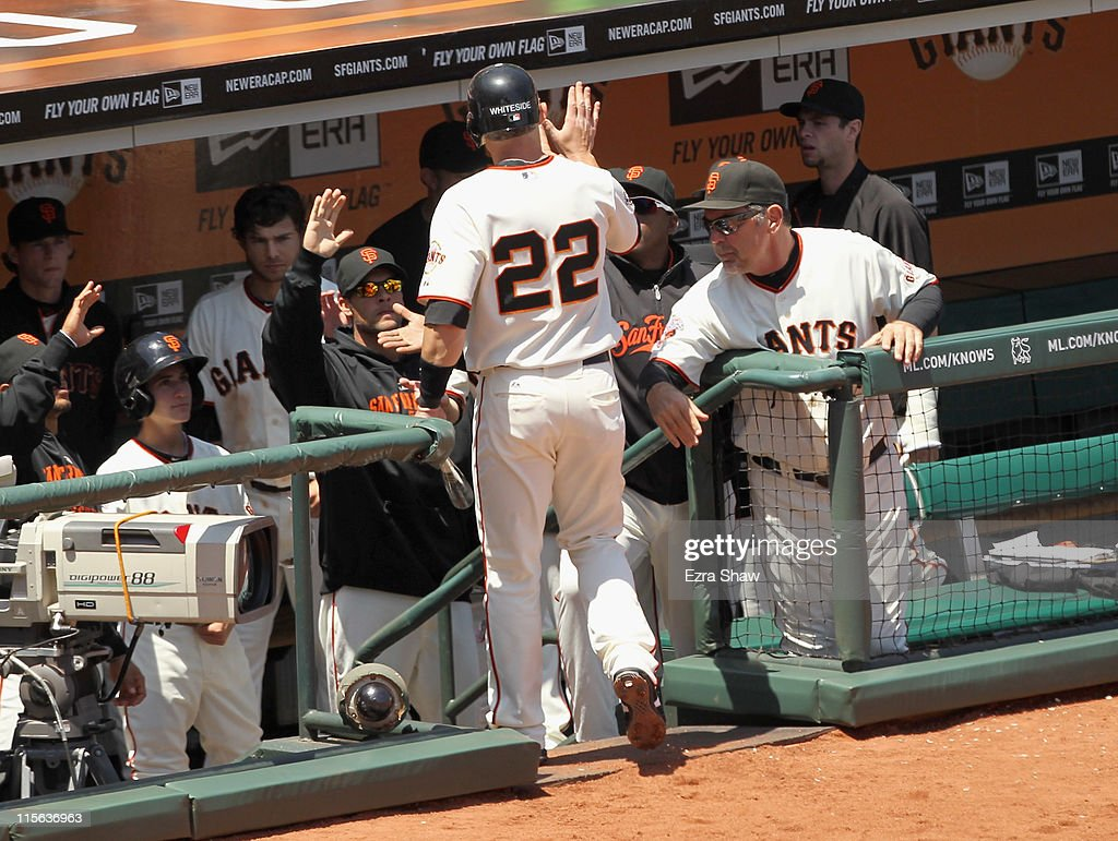 Eli Whiteside #22 of the San Francisco Giants is congratulated by teammates after he scored in the sixth inning against the Washington Nationals at AT&T Park on June 8, 2011 in San Francisco, California.